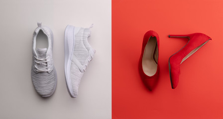 A studio shot of pair of running vs high heel shoes on color background. Flat lay. Wall mural