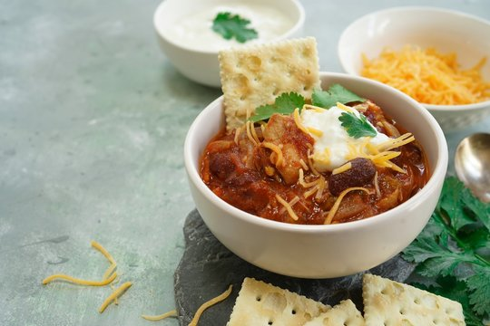 Homemade Chili bowl served with crackers, selective focus
