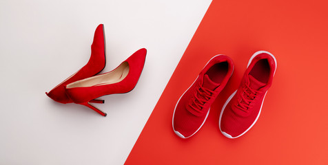 A studio shot of pair of running vs high heel shoes on color background. Flat lay. Fototapete