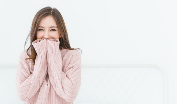 Portrait of young beautiful asian woman relax in her bedroom. Smile happy face asian girl wear winter cloth. Beauty treatment perfect clear skin japanese makeup  lifestyle concept banner background