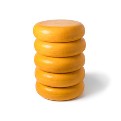 Stack of whole yellow cheeses
