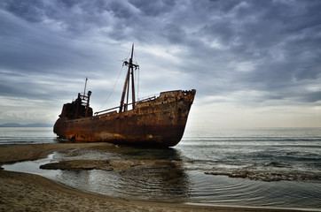 Fotobehang Schip Dimitrios is an old ship wrecked on the Greek coast and abandoned on the beach