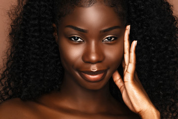 Beauty spa treatment concept.  African Skincare model portrait  with perfect dark skin and curly hair.