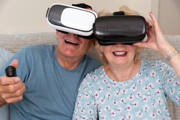 Portsmouth UK, May 2019. Elderly couple having fun wearing virtual reality goggles