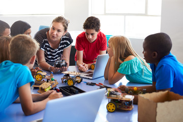 Students In After School Computer Coding Class Building And Learning To Program Robot Vehicle