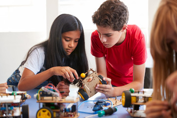 Two Students In After School Computer Coding Class Building And Learning To Program Robot Vehicle Wall mural