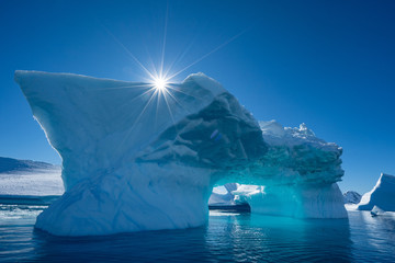 Deurstickers Antarctica Iceberg and a sun in Antarctica