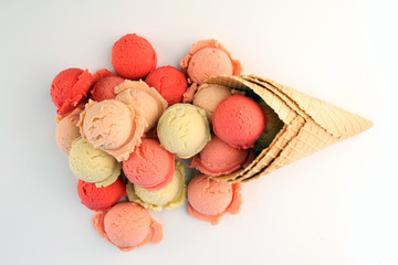 Set of ice cream scoops of different colors and flavours in the summer