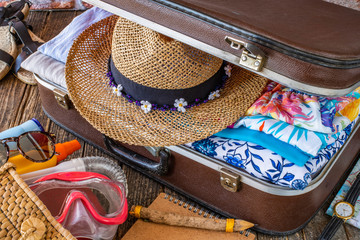 Suitcase preparation for a summer holiday , Retro , vintage and old luggage