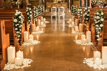 Catholic temple decorated with flowers and candles for wedding Wall mural
