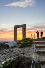 Tourists photograph the Portara of Naxos during sunset, Naxos, Greece
