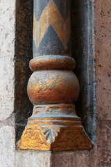 Golden base of a small decorative pillar (column) with engraved floral inscriptions at the ancient public mosque of Sultan Hassan, Old Cairo, Egypt