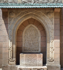 Stone sculpted drinking fountain (Sabil) with engraved floral decorations at the public garden of The Manial Palace of Prince Mohammed Ali Tewfik, Cairo, Egypt