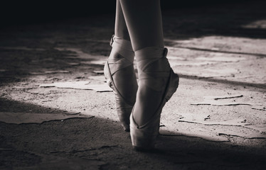 Close-up black and white photo of ballerina, pointe shoes.