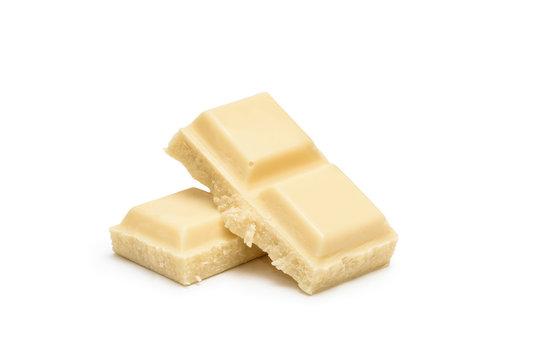 Cubes of white chocolate bar isolated on white background