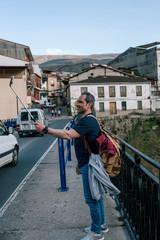 Man making himself a selfie in a nice town