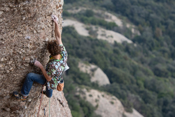 Climber sending a difficult route on sport climbing zone in Montserrat
