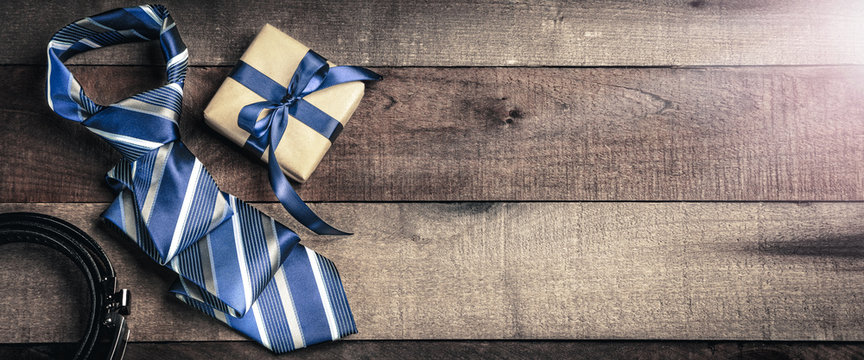 Tie Belt And Gift Box  On Wooden Table With Sunlight - Fathers Day Concept