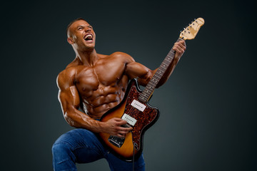 Shirtless Muscular Men Playing Guitar