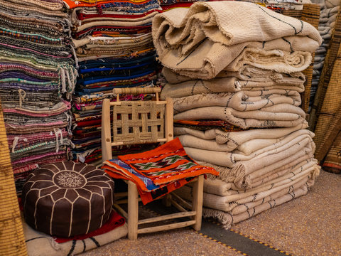 Traditional african arabian moroccan marrakech carpet market, shop with carpets and textile marketplace