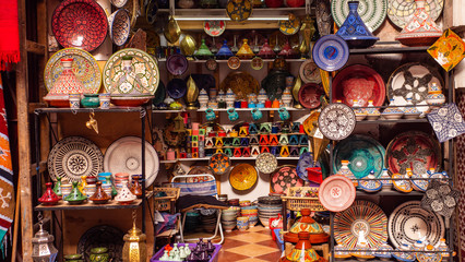 Traditional Moroccan marrakech market with plates and tajin tagine. Handmade ceramic plates. Arabian colorful ramadan design Wall mural
