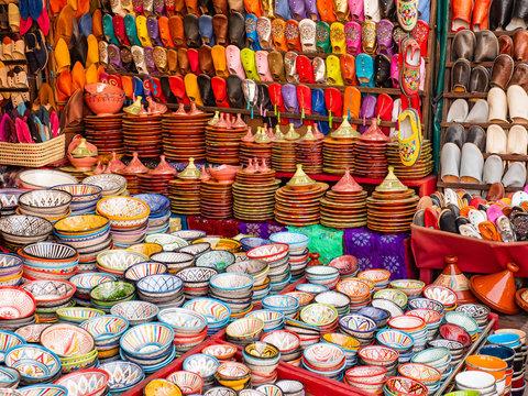 Traditional Moroccan marrakech market with plates and tajin tagine. Handmade ceramic plates. Arabian colorful ramadan design