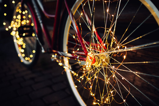 Christmas lights on bike background texture in city