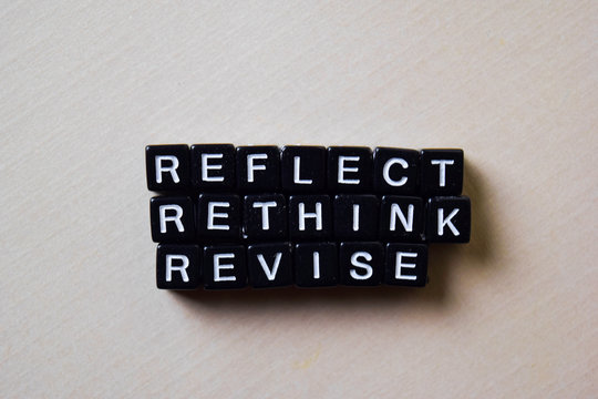 Reflect - Rethink - Revise on wooden blocks. Business and inspiration concept