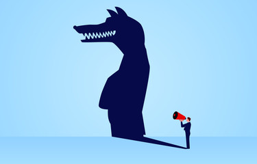 The shadow of a businessman holding a megaphone standing and shouting is a wolf