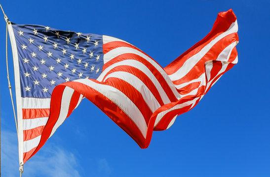 Jumbo beautiful American flag on a flying against a sky
