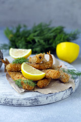 fried fish for lunch, with lemon and herbs