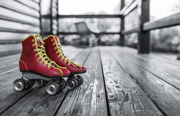Roller skates with roller blades on the terrace