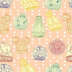 Seamless pattern with hand drawn knitted hats and berets. Colored objects.