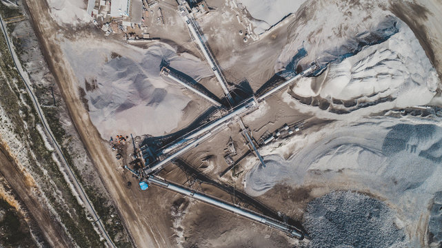 Aerial view of the granite - gravel pit. Equipment for processing and crushing stones