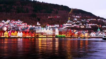 Wall Mural - Bergen, Norway. View of harbour old town Bryggen in Bergen, Norway in the evening. Famous landmarks at sunset. Time-lapse with car traffic and boats