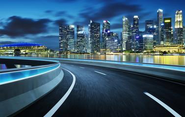 Highway overpass modern Singapore city skyline background . Night scene . Fototapete