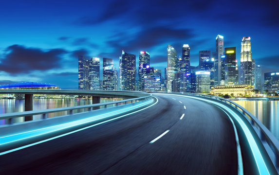 Highway overpass modern Singapore city skyline background . Night scene .