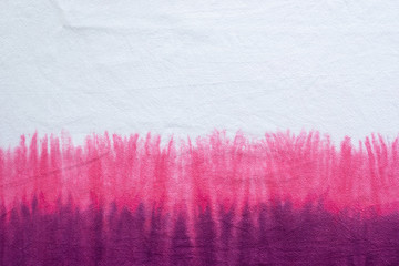 tie dye pattern hand dyed on cotton fabric dip dye technique abstract background.