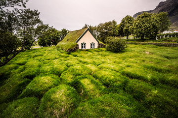 Amazing view of turf church Hofskirkja. Location place of Iceland, small village Hof, Europe.