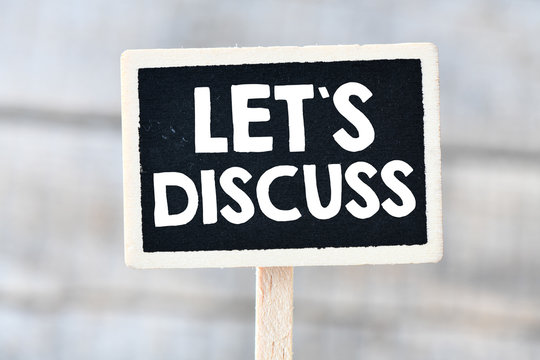Let`s discuss. Handwriting text let`s discuss. Business Concept.