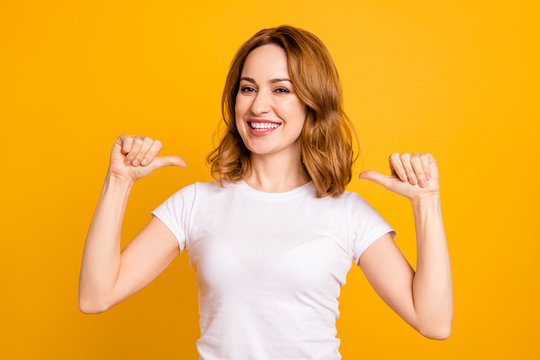 Close up photo amazing beautiful she her lady thumbs indicate direct chest self-confident toothy I am best choice choose pick select me advice wear casual white t-shirt isolated yellow background