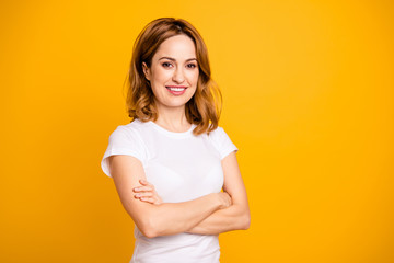 Close up photo beautiful amazing she her pretty attractive lady arms hands hold crossed sincere kindhearted self-confident short hairdress wear casual white t-shirt isolated yellow background