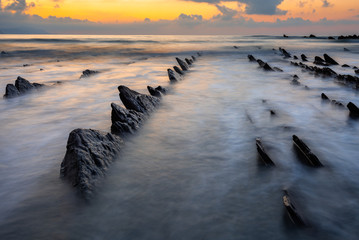 Flysch of Sakoneta beach at sunset, Basque Coast Geopark, Spain