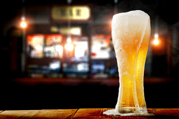 Aluminium Prints Beer / Cider Cold beer in glass and bar background