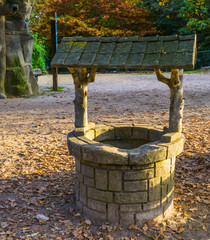 Foto auf AluDibond Fantasie-Landschaft classical water well, medieval looking architecture, historical decorations