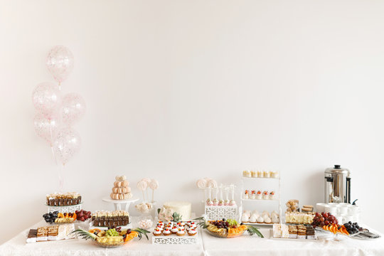 Delicious sweet buffet with cupcakes. Candy Bar.