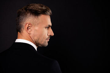Close-up rear back behind profile side view portrait of his he nice-looking attractive well-groomed chic bearded candid guy finance executive director isolated over dark black background