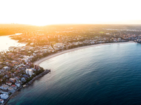 Aerial evening sunset drone shot of Manly, a beach-side suburb of northern Sydney, in the state of New South Wales, Australia. Famous Manly Beach in the foreground, a popular tourist destination.