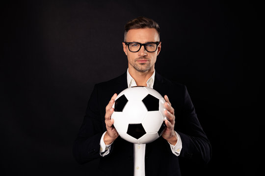 Close-up portrait of his he nice attractive content executive team leader professional director clerk holding in hands ball career development isolated over black background