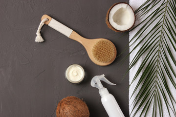 Coconut, tropical leaf and care products on a colored background top view. Cosmetics with coconut extract for hair, body, face. Skin care, skin hydration. flatlay